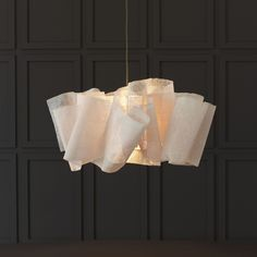 The Anders Light, sculpted from layers of banana fiber, draped and stitched around the central light fixture.