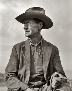 "A New Beginning: October 1939. ""Ex-Nebraska farmer now developing farm out of the stumps. Bonner County, Idaho."" Medium-format nitrate negative by Dorothea Lange for the Farm Security Administration.  ""This is why NONE of you should wear your ""cowboy"" hats or anything else that takes your fancy from J Peterman's. Do you see how this man looks, how right that hat fits him in every way? On you it has the exact opposite effect. I'm begging you, put the hat down and just walk away."""