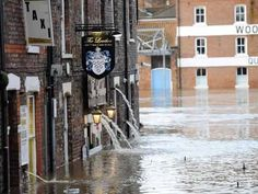 It's raining, it's pouring: Water runs out of flooded properties after the River Ouse bursts its banks in York city centre earlier this morning York City Centre, Wild Weather, Great British, North Yorkshire, Lake District, Over The Years, Britain