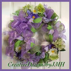 Purple Spring Deco Mesh Wreath by CreativeDesignsJMH on Etsy https://www.etsy.com/listing/184268316/purple-spring-deco-mesh-wreath