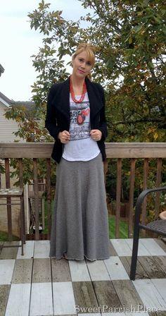 Graphic Tshirt, black moto jacket, grey maxi skirt