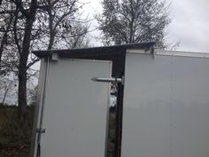 side view of how the awning goes over the back doors.  Awning slips into U brackets attached to side of trailer
