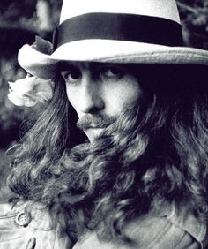 im pretty sure that this is george harrison. he is slowly becoming my new favorite Beatle.