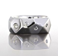 unique men's custom faceted design wedding band from Craft-Revival Jewelers