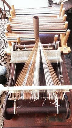 http://www.ravelry.com/projects/jeen/direct-warping-a-cricket-loom-with-a-warping-board