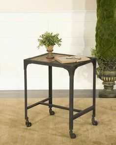 """City Park, End Table by Uttermost by Uttermost. $272.80. Material: IRON+WOOD. Rustic, antiqued black iron frame and castors with vintage, multicolor painted old wood slats. Dimensions: 16""""D x 20""""W x 25""""H"""