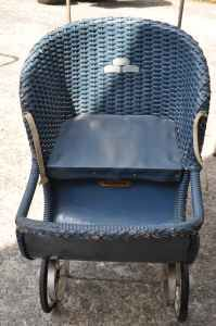 antique dark blue wicker very much like the doll stroller I had as a little girl.