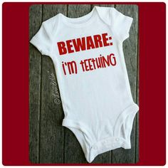 Check out this item in my Etsy shop https://www.etsy.com/listing/249327977/beware-im-teething-funny-baby-clothes