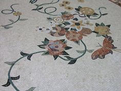 Artistic tile floor design in the Bellagio Conservatory in Las Vegas! http://www.carolinatileandstone.com/tile.html