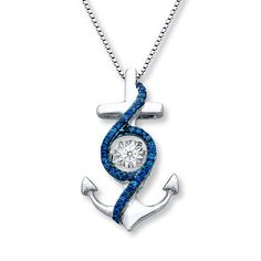 Shaped like an anchor, this sterling silver necklace from the Diamonds in Rhythm® collection features a sparkling round white diamond in the center that moves with your every move. Jared Vivid® blue diamonds swirl from top to bottom and frame the center for exciting contrast. The pendant has a total diamond weight of 1/6 carat, and suspends from an 18-inch box chain that secures with a lobster clasp. Blue diamonds are treated to permanently create the intense blue color. Diamond To...