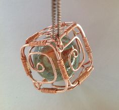 Wire-wrapped copper cube pendant with gemstone ball. - Wire-wrapped copper cube pendant with gemstone ball. Wire Pendant, Wire Wrapped Pendant, Wire Wrapped Jewelry, Key Pendant, Diamond Pendant, Pendant Jewelry, Wire Jewelry Making, Diamond Jewelry, Wire Jewelry Designs