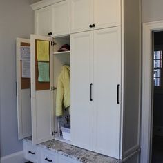 doors to hide stuff...corkboard with reminders  Entry Mudroom Design, Pictures, Remodel, Decor and Ideas - page 16