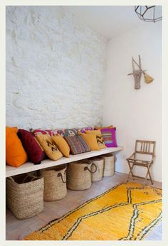 An Indian Summer porch space : cushions, built in bench seat & shoe baskets