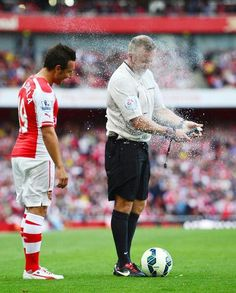 Santi Cazorla gets sprayed in the face with disappearing spray during the 2014/15 game against Crystal Palace as the referee gets to grips with the new tool.