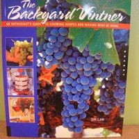 """December 9th, 2012    Looking for more ideas that can be wrapped and placed under the tree this year? Double A Vineyards offers a variety of books that are great for the new and soon to be hobbyists. Weather you're growing grapes for eating, or to make wine we've got a book for you! This book is called """"The Backyard Vintner"""" by Jim Law. It is a comprehensive guide to at home wine making. This book teaches readers how to start and maintain a small vineyard."""