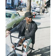 """nytimesfashion: Any given moment I could jump on my bicycle no matter what Im wearing"""" says professional BMX biker @nigelsylvester. The stylish athlete has been spotted at numerous fashion shows and he had the chance to flaunt his tricks on a runway for VFiles last September. Read about his latest projects in this week's Men's Style at nytimes.com/fashion in print on Friday. Photo by @jokemichaels"""