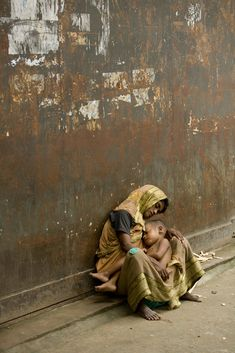 A mother and son homeless on the streets of Dhaka Bangladesh. An image I will never forget in my 2 years living and working there.