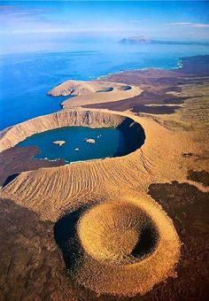 Aerial view of volcanic craters, Isabela Island, Galapagos Islands, Ecuador. The largest of the Galapagos Islands, Isabela is one of the most volcanically active places in the world. © Frans Lanting (V) Photo Volcan, Places To Travel, Places To See, Belle Image Nature, Equador Quito, Frans Lanting, Photos Voyages, Galapagos Islands, Aerial Photography