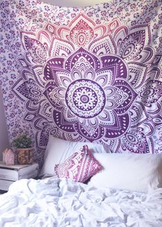 Top off your bed or accent a wall with this unique boho tapestry, featuring a bold purple and pink mandala pattern on soft white fabric. This tapestry also doubles as a picnic blanket, perfect for fes