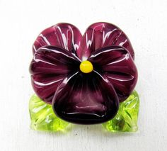 Lampwork pansy made of amethyst purple and green glass Perfectly fits for a pendant  Size of bead: approximately 30 mm  The sizes are approximate as each bead is handmade and may vary slightly (2-3mm).   Diameter of hole: 2mm The hole is running in vertical direction Flat base  Available 2 beads   *** All beads are made by me in my home studio in Saint-Petersburg and are kiln annealed for lasting durability.  Find more of my lampwork glass beads here in my Etsy shop: https://www.ets...