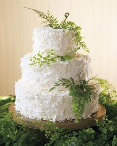 Keeping with the verdant décor of this coastal wedding in California, this carrot cake was finished with cream cheese frosting and coconut shavings, and decorated with three types of ferns.
