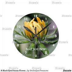 A Black Eyed Susan Flower Unfolding Round Clock.  From Smilin' Eyes Treasures at Zazzle.