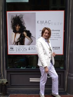 Matthew at museum entrance with KMAC Couture banner
