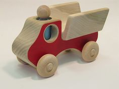 I love these classic wooden toy vehicles from Etsy–they remind me of vintage Konrad Keller toys with their little peg people.