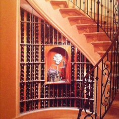 Love glassed in wine cellar under stairs with decorative for American dream homes magazine