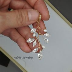 Earrings featue white fresh water pearls, very sparkling high quality Swarovski Rhinestones and stunning cubic zirconia embellished ear wires.