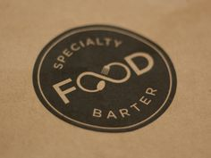 Logo for a barter network that deals with specialty and locally sourced food products.
