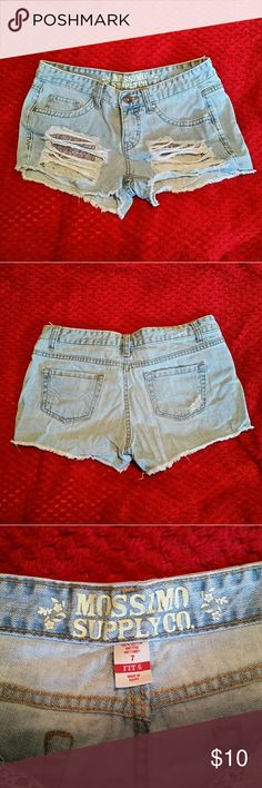 Mossimo distressed denim shorts Cute heavily distressed Mossimo denim shorts. Rips in front show off adorable floral pockets underneath. Lightly worn size 7. Mossimo Supply Co. Shorts Jean Shorts