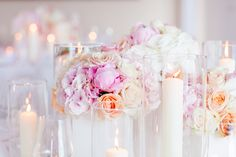 centerpiece with roses, hydrangeas and peonies in beautiful shades of blush pink, white and peach, apricot by TML | TABEA MARIA-LISA at Restaurant Schloss Oberhofen | picture taken by DAVID AND KATHRIN Photography