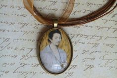 """Nicholas Hilliard miniature """"Man in Flames"""" necklace...or as we know, it's Matthew Roydon (Matthew de Clermont) from the All Souls Trilogy Made by NolaBijoux on Etsy"""