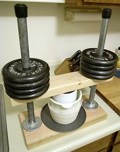 Another press using dumbells.  I like this home made cheese press...