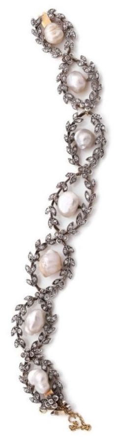 A BELLE EPOQUE DIAMOND, NATURAL PEARL, GOLD AND SILVER BRACELET, LATE 19TH CENTURY. The articulated bracelet designed as a series of laurel leaf links set with rose-cut diamonds and seven natural pearls, mounted in silver and gold. #antique #BelleÉpoque #bracelet