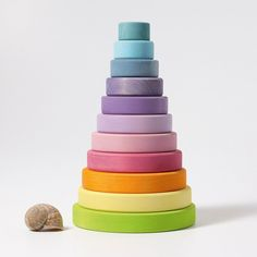 With the large Conical Tower the children can sort, stack and build. While stacking, the eye-hand coordination is stimulated and fine motor skills are trained. Ten discs for stacking.Materials: lime wood, non-toxic water based color stain. Grimm's Toys, Felt Toys, Stacking Toys, Natural Toys, Fine Motor Skills, Cool Toys, Sorting, Wood Grain, Fine Motor