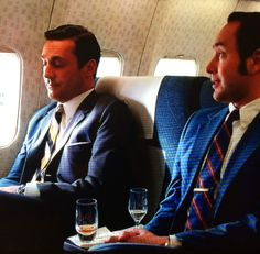 Looked like Don had his usual whiskey and Pete got some complimentary Champers on the plane.