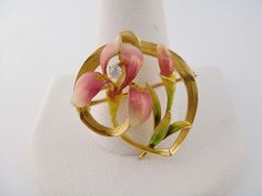 Art nouveau gold and enamel iris pin with a diamond in the flower