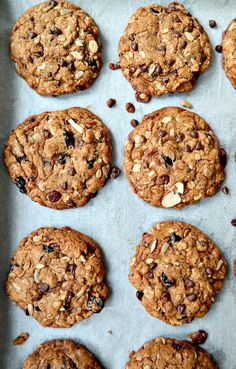 Cherry Chocolate Muesli Cookies - VEGAN - Bites of wholesome golden goodness with tart dried cherries, chocolate chips, date crumbles, chewy raisins and crunchy oats. Easy to bake and absolutely delicious! From The Glowing Fridge.