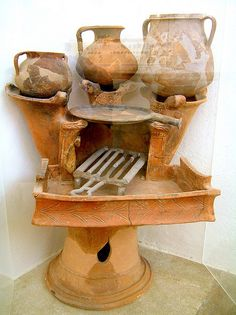 Ancient Greek kitchen, century B. Also Greek could made pizza using this type of kitchen.Archaeological Museum of Delos, Greece