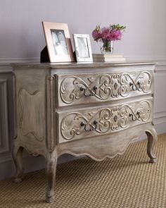 "The beautiful ""Henning"" chest is designed in the style of Louis XVI. Lovely scroll-work, a scalloped apron and cabriole legs give it  elegance"
