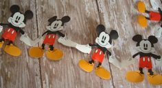 Mickey Mouse 9 ft Garland by Disney, http://www.amazon.com/dp/B007MHSV9Q/ref=cm_sw_r_pi_dp_r9hZrb02X6FHM