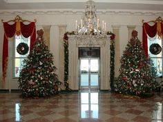 The East Room decorations celebrate the joy of American folk art. Artistic traditions are represented throughout the room's holiday decor, from handcrafted wooden ornaments to needlework to antique paintings.