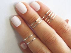 Silver stacking rings, and pretty simple nails