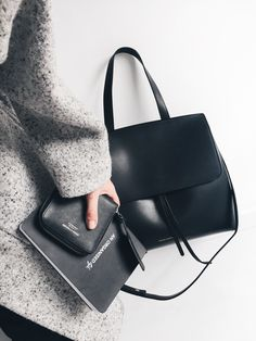 Bash coat, Acne Studios wallet and Mansur Gavriel lady bag. Via Mija