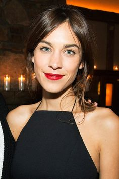 Tousled bobs, ombre waves and choppy cuts - see Alexa Chung's hair history - A casual ponytail and red lipstick for a Mytheresa.com dinner for Rag & Bone.