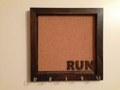 I can definitely make this myself...use frame and back with cork board to pin race numbers to. Screw in hooks at bottom & add customized words of choice. Wooden RUN with Cork board Shadow Box. Sports by sharonshobbies, $25.00
