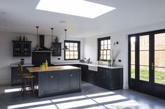 A beautiful contemporary deVOL Shaker Kitchen with polished concrete floor, deep grey-blue cabinets and brass door furniture. Devol Shaker Kitchen, Devol Kitchens, Home Kitchens, Home Decor Kitchen, Kitchen Living, New Kitchen, Long Kitchen, Living Room, Kitchen Diner Extension