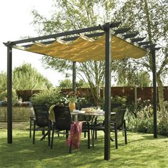 Wooden canopy with ivy in the back corner of the garden over the furniture and hang a canopy under in the summer?